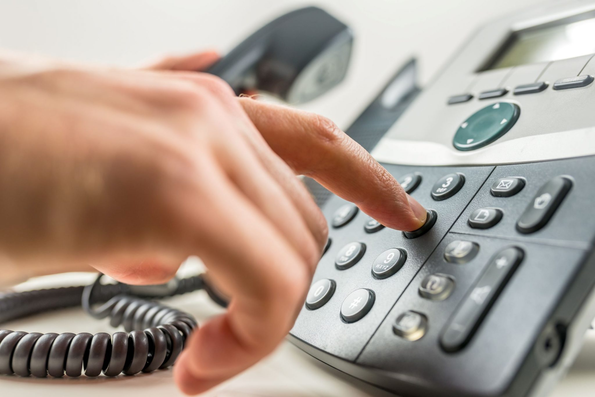 Hand dialing on a landline phone