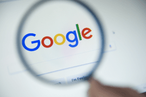 Magnifying glass over Google search bar home page