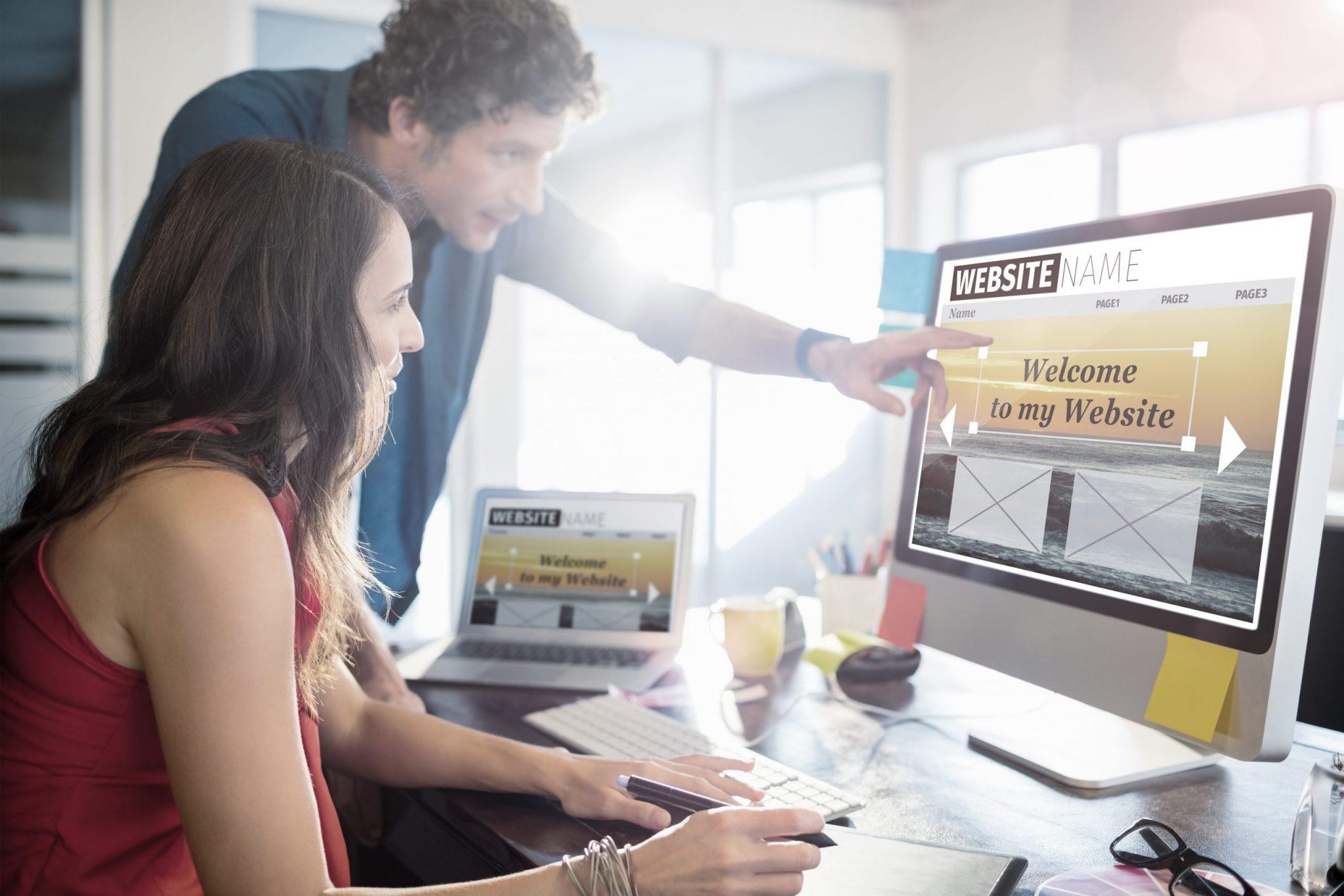Man helping woman design her website
